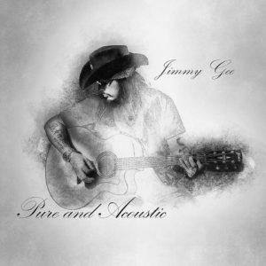 Jimmy Gee mit Gitarre und Cowboyhut in schwarz weiss